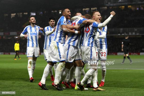Laurent Depoitre of Huddersfield Town celebrates after scoring his sides third goal with his Huddersfield Town team mates during the Premier League...