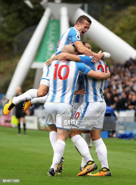 Laurent Depoitre of Huddersfield Town celebrates as he scores their second goal with team mates during the Premier League match between Huddersfield...