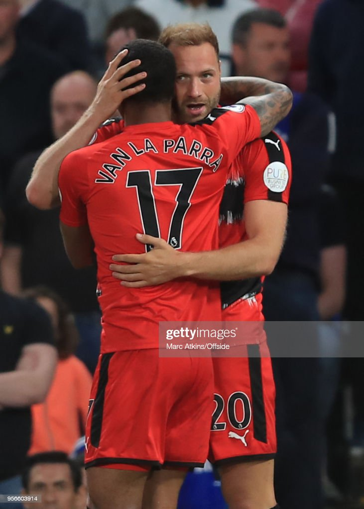 Laurent Depoitre of Huddersfield Town celebrates with Rajiv van La Parra during the Premier League match between Chelsea and Huddersfield Town at Stamford Bridge on May 9, 2018 in London, England.