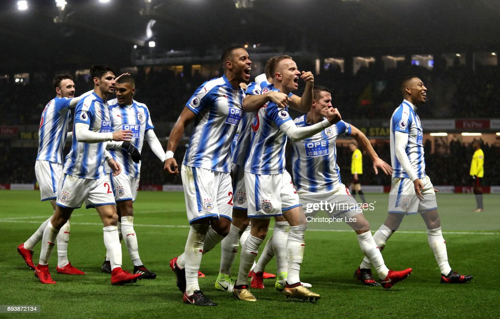Laurent Depoitre of Huddersfield Town celebrates with team mates after scoring his sides third goal during the Premier League match between Watford and Huddersfield Town at Vicarage Road on December 16, 2017 in Watford, England.