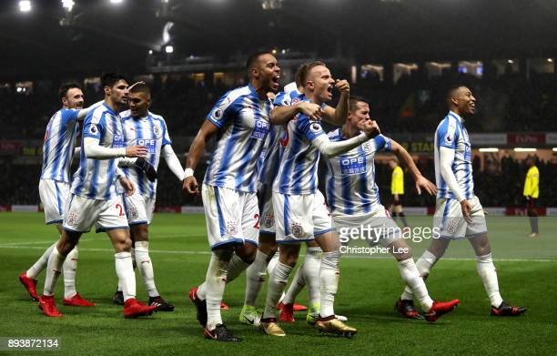 Laurent Depoitre of Huddersfield Town celebrates with team mates after scoring his sides third goal during the Premier League match between Watford...