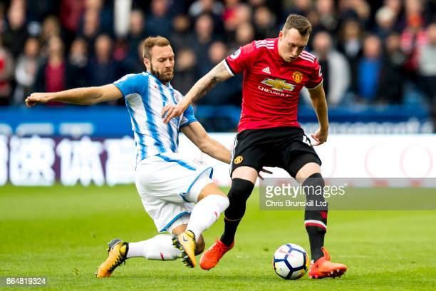 Laurent Depoitre of Huddersfield Town challenges Phil Jones of Manchester United during the Premier League match between Huddersfield Town and...
