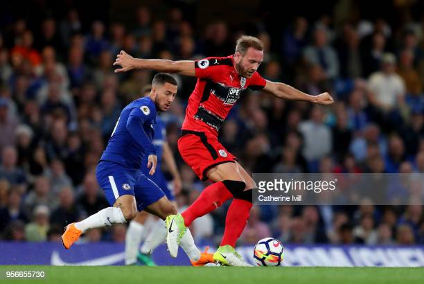 Laurent Depoitre of Huddersfield Town gets away from Eden Hazard of Chelsea during the Premier League match between Chelsea and Huddersfield Town at...