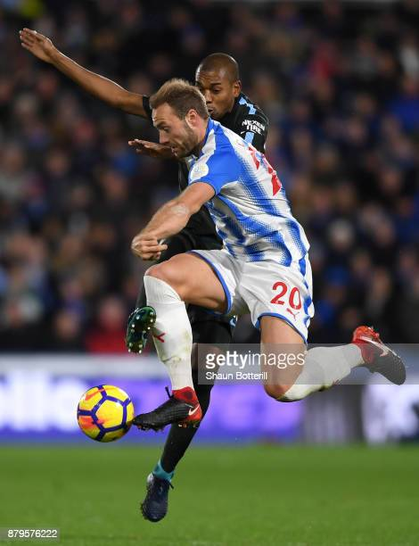 Laurent Depoitre of Huddersfield Town goes past Fernandinho of Manchester City during the Premier League match between Huddersfield Town and...