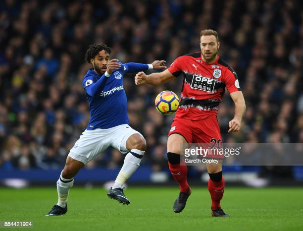 Laurent Depoitre of Huddersfield Town is challenged by Ashley Williams of Everton during the Premier League match between Everton and Huddersfield...