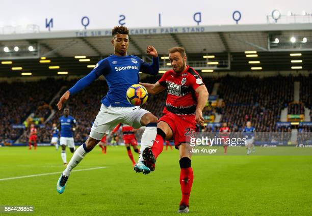 Laurent Depoitre of Huddersfield Town is challenged by Mason Holgate of Everton during the Premier League match between Everton and Huddersfield Town...
