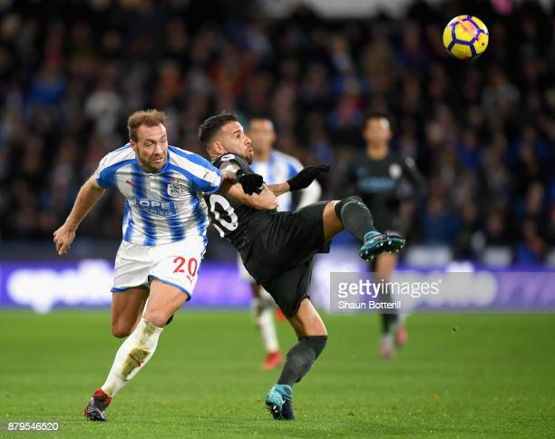 Laurent Depoitre of Huddersfield Town is challenged by Nicolas Otamendi of Manchester City during the Premier League match between Huddersfield Town...