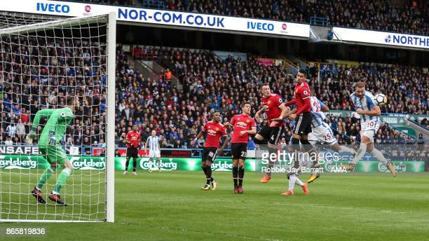 Laurent Depoitre of Huddersfield Town misses with a header during the Premier League match between Huddersfield Town and Manchester United at John...