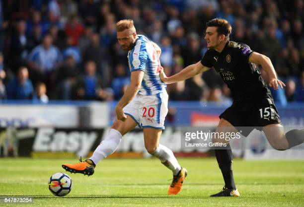 Laurent Depoitre of Huddersfield Town scores his sides first goal during the Premier League match between Huddersfield Town and Leicester City at...