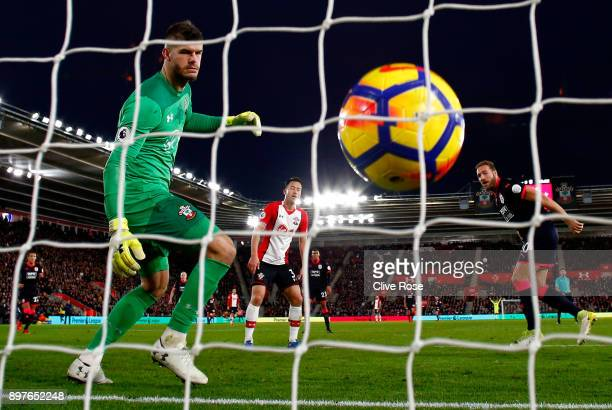 Laurent Depoitre of Huddersfield Town scores his sides first goal past Fraser Forster of Southampton during the Premier League match between...