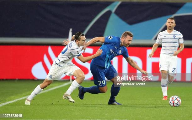 Laurent Depoitre of KAA Gent battles for the ball with Mykola Shaparenko of Kyiv during the UEFA Champions League PlayOff first leg match between KAA...