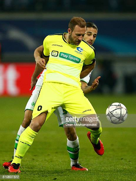 Laurent Depoitre of KAA Gent is tackled by Ricardo Rodriguez of Wolfsburg during the UEFA Champions League round of 16 first leg match between KAA...