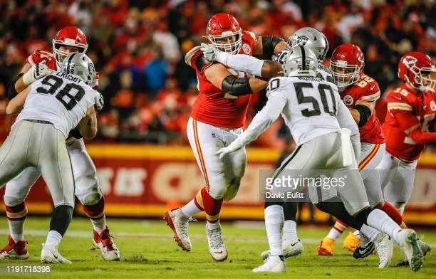 Laurent DuvernayTardif of the Kansas City Chiefs blocks Johnathan Hankins of the Oakland Raiders during the fourth quarter at Arrowhead Stadium on...