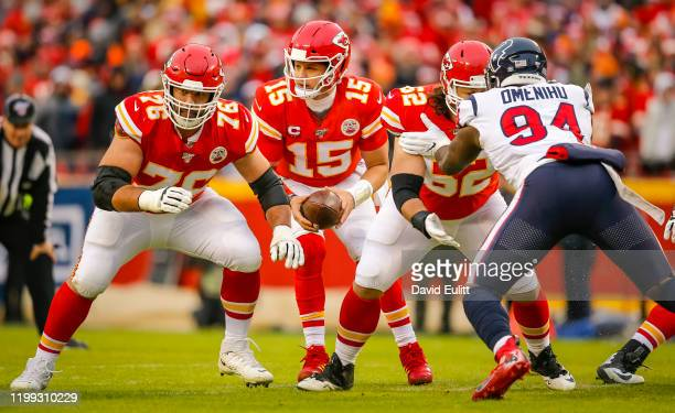 Laurent DuvernayTardif of the Kansas City Chiefs prepares to block for Patrick Mahomes of the Kansas City Chiefs during the second quarter of the AFC...