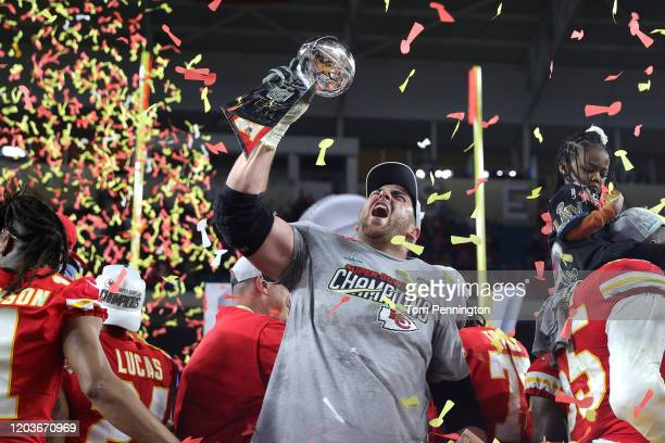 Laurent DuvernayTardif of the Kansas City Chiefs raises the Vince Lombardi Trophy after defeating the San Francisco 49ers 3120 in Super Bowl LIV at...