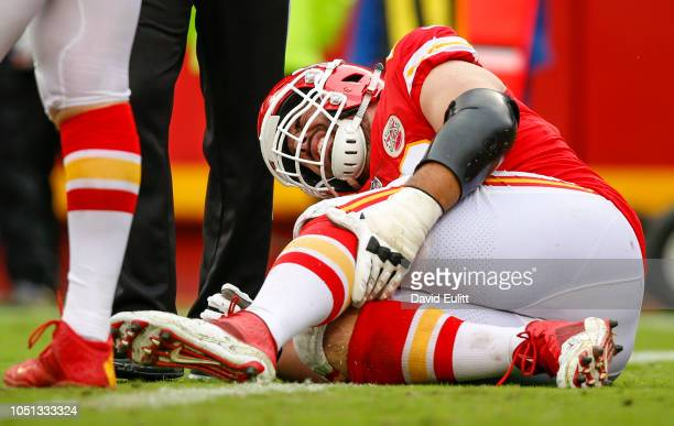 Laurent DuvernayTardif offensive guard with the Kansas City Chiefs grabbed his injured leg in the game against the Jacksonville Jaguars at Arrowhead...