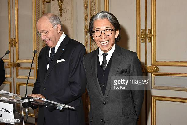 Laurent Fabius and Kenzo Takada attend as Kenzo Takada receives the Medal of Chevalier de La Legion d'Honneur at Conseil Constitutionnel on June 2...