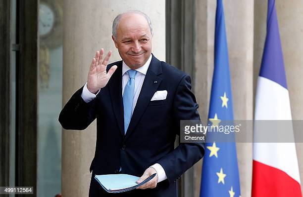Laurent Fabius French Minister of Foreign Affairs and International Development arrives to attend a meeting with French President Francois Hollande...