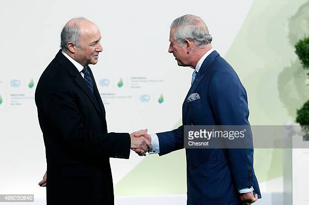 Laurent Fabius French Minister of Foreign Affairs and International Development welcomes Prince Charles Prince of Wales as he arrives for the COP21...