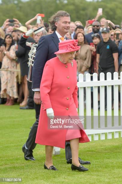 Laurent Feniou and Queen Elizabeth II attend Cartier Queen's Cup Polo 2019 on June 16, 2019 in Windsor, England.