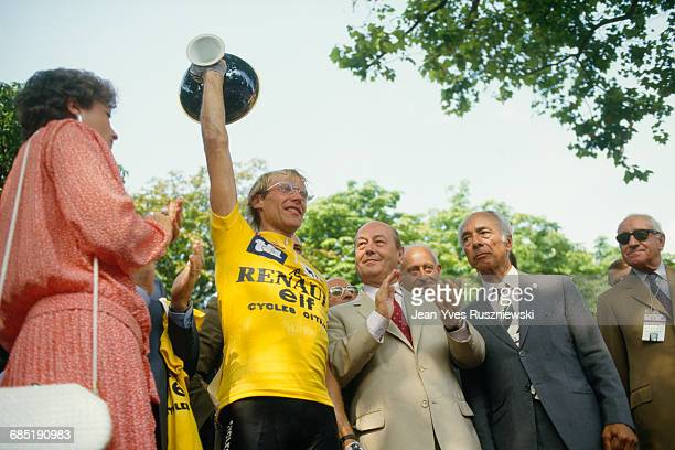 Laurent Fignon holding the trophy after his victory in the 1983 Tour de France.