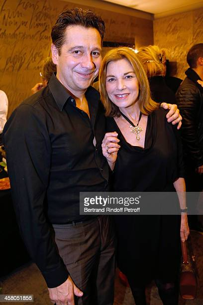 Laurent Gerra and actress Nicole Calfan pose backstage following the show of impersonator Laurent Gerra Un spectacle Normal at L'Olympia on December...