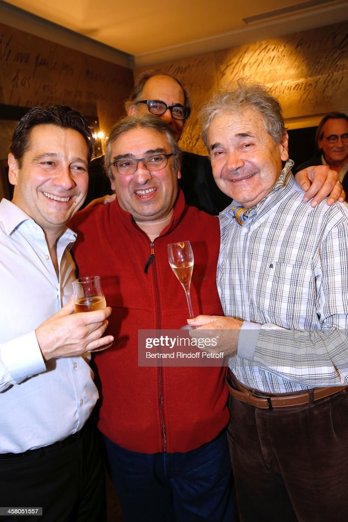 Laurent Gerra, Bandmaster Frederic Manoukian (Fred) and singer Pierre Perret pose backstage following the show of impersonator Laurent Gerra 'Un spectacle Normal' at L'Olympia on December 19, 2013 in Paris, France.