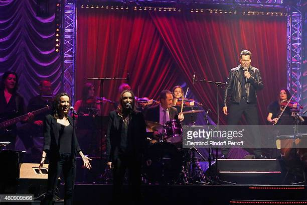 Laurent Gerra imitates Singer Johnny Hallyday with his Chorussingers Salome Stevenin and Christaline during the Laurent Gerra Show at Palais des...