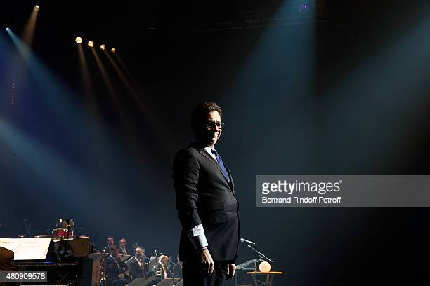 Laurent Gerra imitates the French President Francois Hollande during the Laurent Gerra Show at Palais des Sports on December 26 2014 in Paris France