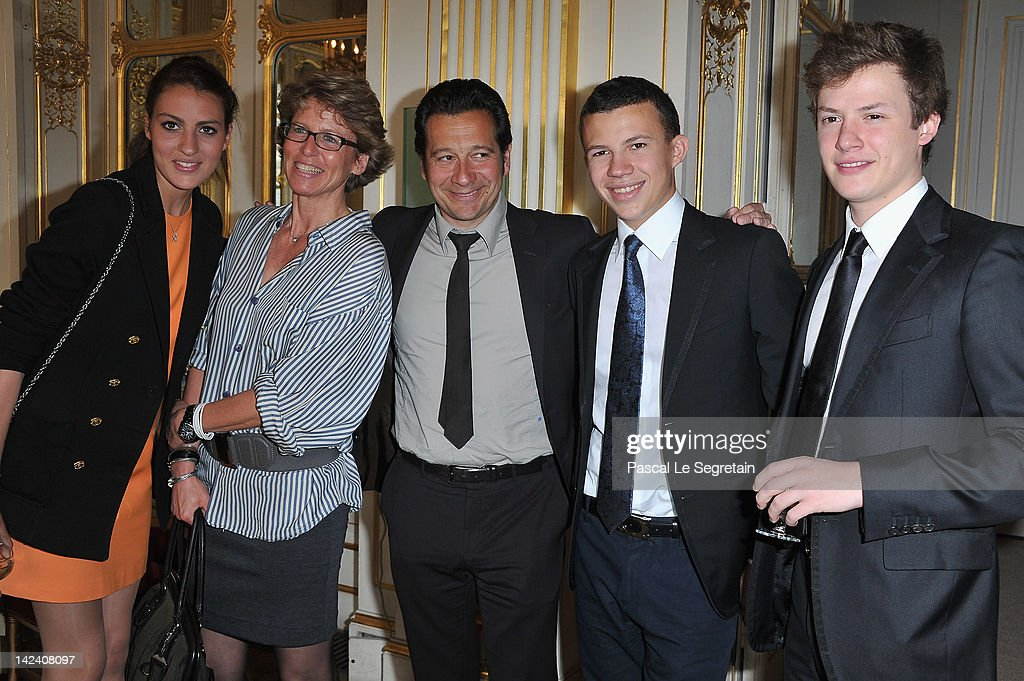 Laurent Gerra (3rdL) poses with ( L-R) Alexia, Valerie, Constentin and Benjamin Rindoff Petroff at Ministere de la Culture on April 4, 2012 in Paris, France.