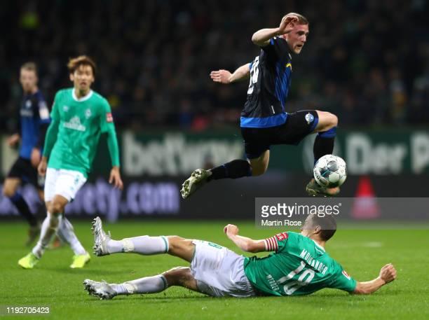 Laurent Jans of SC Paderborn 07 is tackled by Niklas Moisander of SV Werder Bremen during the Bundesliga match between SV Werder Bremen and SC...