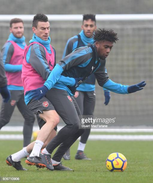 Laurent Koscielny and Alex Iwobi of Arsenal during a training session at London Colney on March 3 2018 in St Albans England