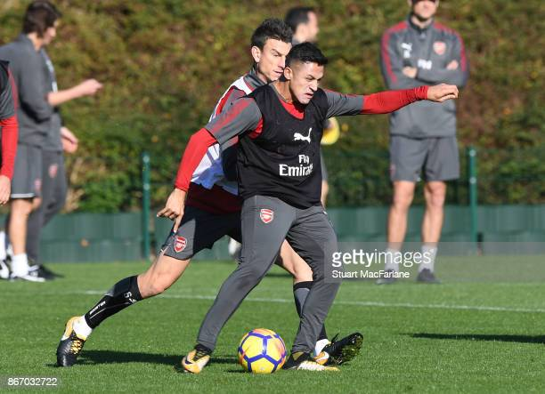 Laurent Koscielny and Alexis Sanchez of Arsenal during a training session at London Colney on October 27 2017 in St Albans England