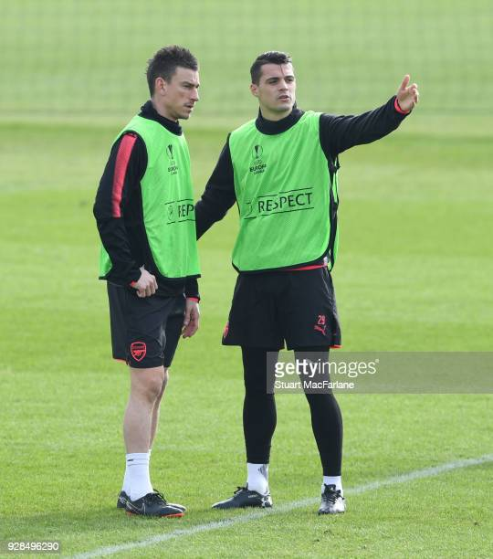 Laurent Koscielny and Granit Xhaka of Arsenal during a training session at London Colney on March 7 2018 in St Albans England