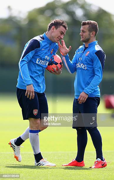 Laurent Koscielny and Jack Wilshere of Arsenal share a joke during a training session ahead of the FA Cup Final match between Arsenal and Hull City...
