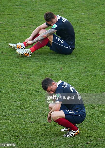 Laurent Koscielny and Mathieu Debuchy of France react after being defeated by Germany 10 during the 2014 FIFA World Cup Brazil Quarter Final match...