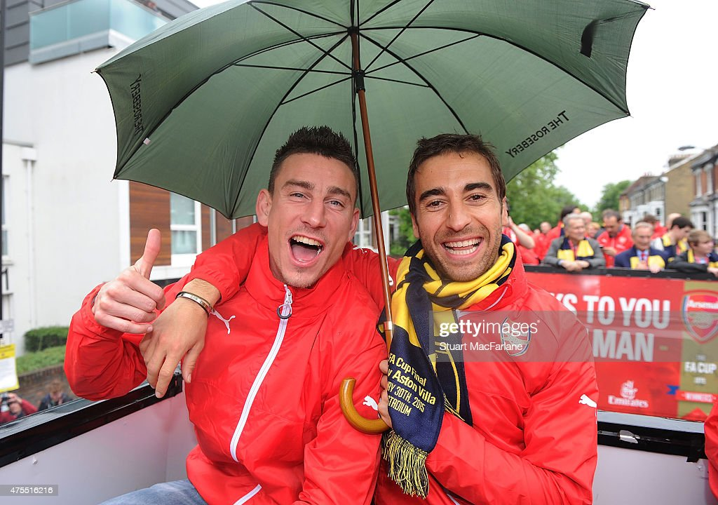 Laurent Koscielny and Mathieu Flamini during the Arsenal FA Cup Victory Parade in Islington on May 31, 2015 in London, England.