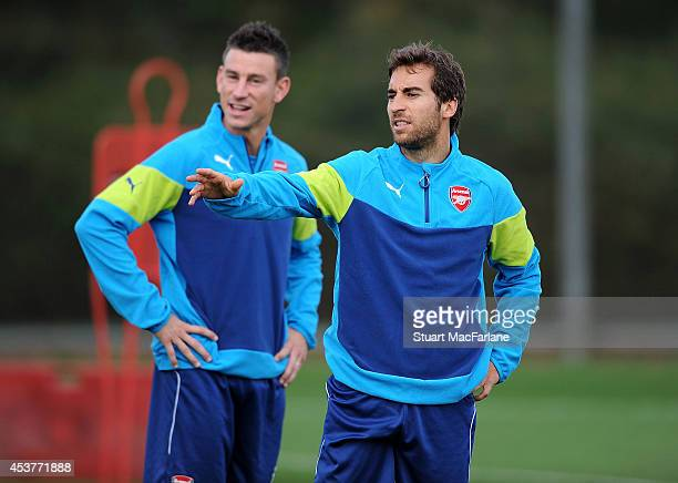 Laurent Koscielny and Mathieu Flamini of Arsenal during a training session at London Colney on August 18, 2014 in St Albans, England.