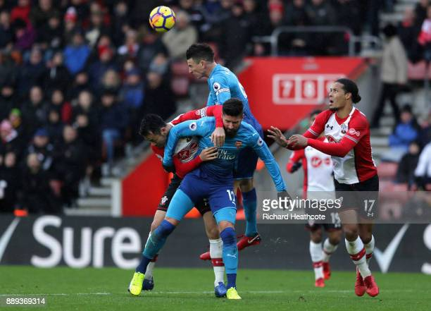 Laurent Koscielny and Olivier Giroud of Arsenal battle for the ball with Maya Yoshida of Southampton during the Premier League match between...