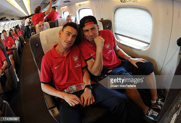 Laurent Koscielny and Olivier Giroud of Arsenal on the Bullet train from Nagoya to Saitama in Japan for the club's pre-season Asian tour on July 23,...