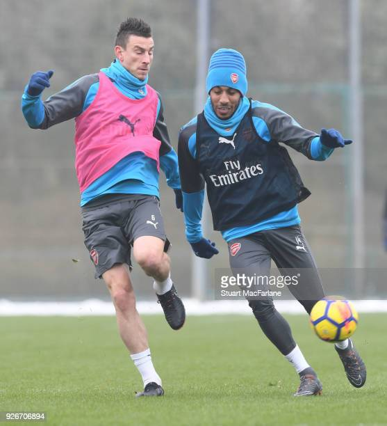 Laurent Koscielny and PierreEmerick Aubameyang of Arsenal during a training session at London Colney on March 3 2018 in St Albans England