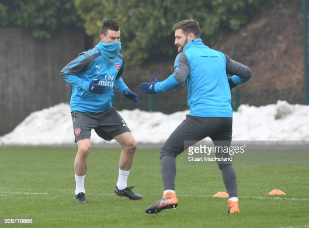 Laurent Koscielny and Shkodran Mustsafi of Arsenal during a training session at London Colney on March 3 2018 in St Albans England
