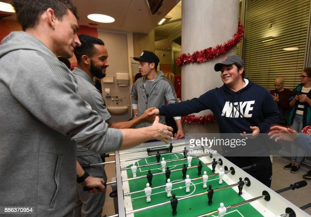 Laurent Koscielny and Theo Walcott visit the Teenage Cancer Trust Unit in University College Hospital on December 5 2017 in London England