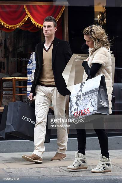 Laurent Koscielny and wife Claire Koscielny seen shopping at Dolce Gabbana on Old Bond St on April 3 2013 in London England