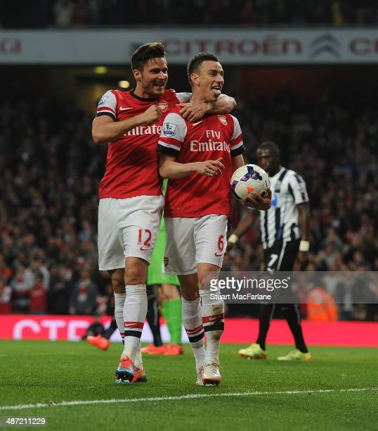 Laurent Koscielny celebrates scoring Arsenal's goal with Olivier Giroud during the Barclays Premier League match between Arsenal and Newcastle United...