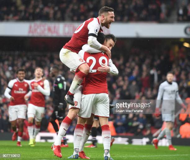 Laurent Koscielny celebrates scoring the 2nd Arsenal goal with Shkodran Mustafi and Granit Xhaka during the Premier League match between Arsenal and...