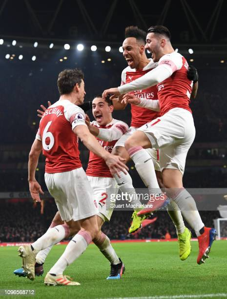 Laurent Koscielny celebrates scoring the 2nd Arsenal goal with Hector Bellerin PierreEmerick Aubameyang and Sead Kolasinac during the Premier League...