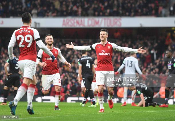 Laurent Koscielny celebrates scoring the 3rd Arsenal goal during the Premier League match between Arsenal and Crystal Palace at Emirates Stadium on...