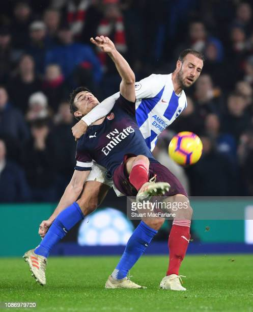 Laurent Koscielny challenged by Glenn Murray of Brighton during the Premier League match between Brighton Hove Albion and Arsenal FC at American...