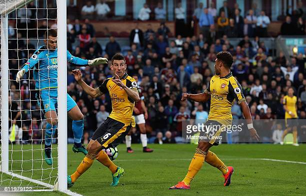 Laurent Koscielny defelcts Alex OxladeChambelrain's shot to score the Arsenal goal during the Premier League match between Burnley and Arsenal at...